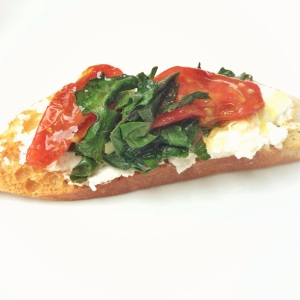 Kale, ricotta and roasted tomato crostini